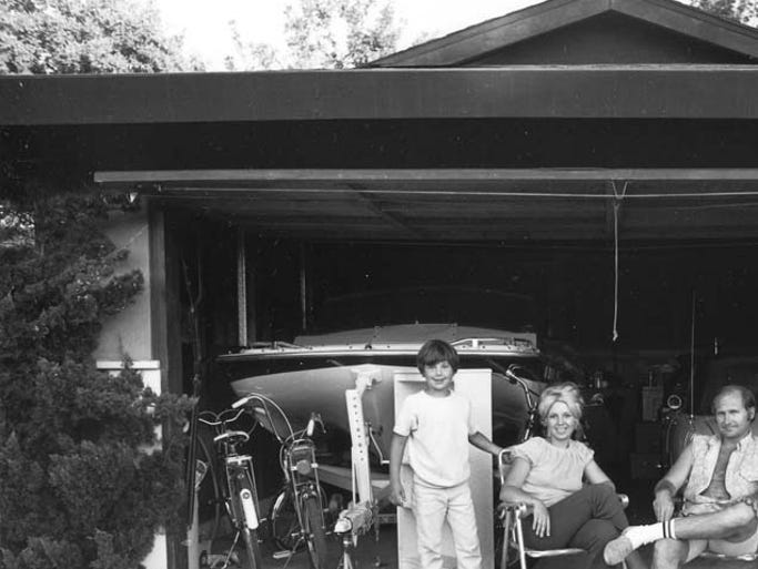 """Our house is built with the living room in the back, so in the evening we sit out front of the garage and watch the traffic go by."" From Bill Owens' series ""Suburbia,"" 1973. Gelatin-silver print, 7 x 9 inches."