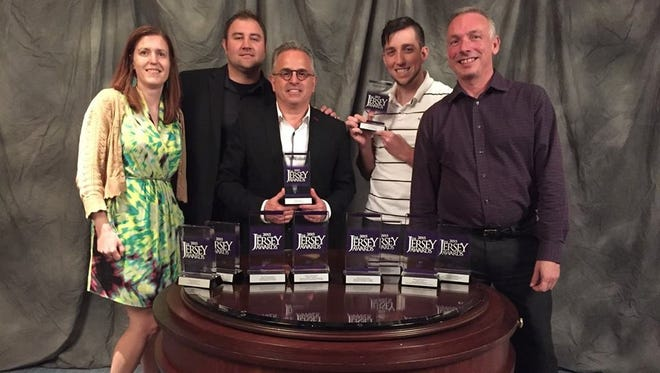 Lambertville-based Oxford Communications recently earned 12 New Jersey Advertising Club Awards, including the prestigious Best of Social Media trophy. Pictured from left are Heather Kolesa, senior art director and studio manager; Michael Gabriel, art director; John Martorana, president-CEO; Anthony Mastoris, junior developer; and Chuck Whitmore, executive vice president and chief creative officer.