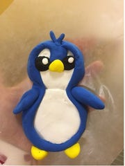 Customers at A.C. Moore Stores on Saturday can make and take this penguin home.