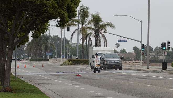 Crews cleaned debris from Gonzales Road in Oxnard Saturday morning after a fatal motorcycle crash in front of Oxnard High School.