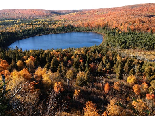 One of the Oberg Mountain overlooks opens onto a view of Oberg Lake. The hike, a Superior Hiking Trail spur, includes a trek through maples. Mosses, mushrooms and lichens can be found all along the route.