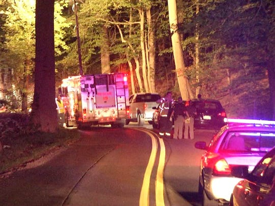 Emergency responders are shown at the scene of a fatal hit-and-run crash that left a bicyclist dead Friday evening.