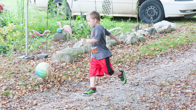Landyn Cooley, 6, has had to relearn many basic things including running and walking after his heart transplant surgery