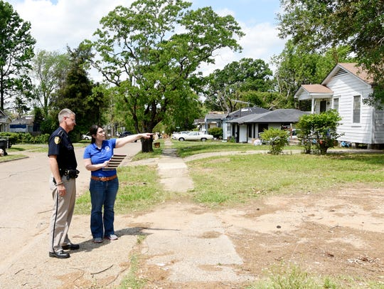 Melissa Wilkins, a FEMA spokeswoman, and Robert Jump of the Caddo Parish Sheriff's Office, tour the Queensborough neighborhood Tuesday afternoon.