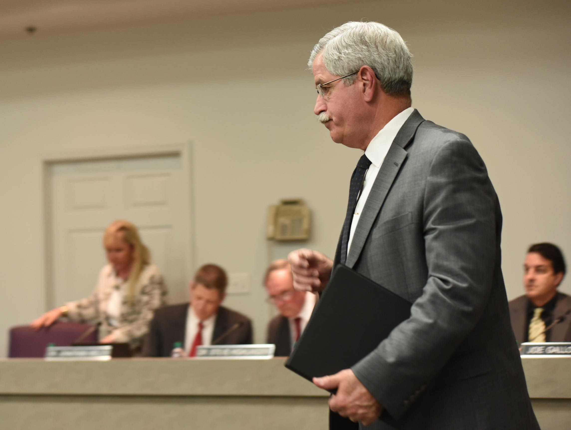 """Hamilton County Schools Superintendent Rick Smith enters a school board meeting room before a short public meeting in Chattanooga, Tenn., Wednesday, Jan. 6, 2016. Tennessee's Ooltewah High School has called off the rest of its basketball season after three of its players were arrested on charges of raping a teammate in an apparent hazing incident. Smith said he was taking this """"very unusual step"""" with the high school """"so that the criminal justice system can work the way we expect."""""""
