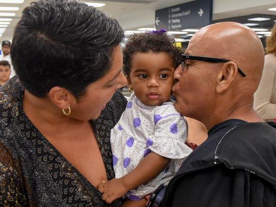Manuel DeJesus of Vega Baja, Puerto Rico kisses Delilah