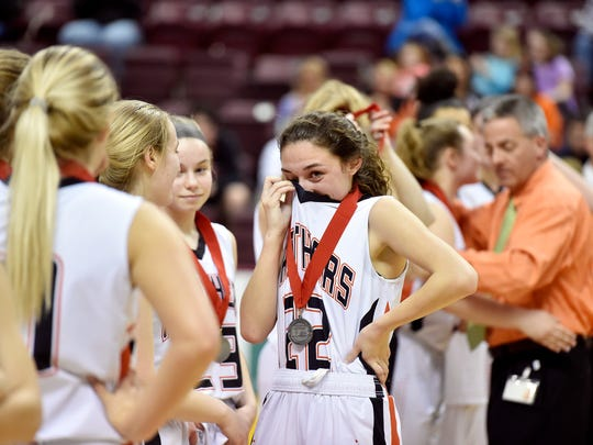 Central York's Sarah Sepic stands with her teammates during the runner-up medal ceremony after the PIAA District 3 Class 6A girls' basketball championship game Wednesday, Feb. 28, 2018, at the Giant Center. Central York lost 37-26 to Central Dauphin in the Panthers' first district title appearance since 1999.