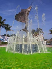 The iconic sailfish fountain in Stuart was turned green