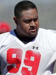 Wisconsin nose tackle Olive Sagapolu will lead a less experienced defensive line for the Badgers this fall.
