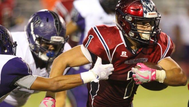 La Quinta High School's Benji Cordova runs for yardage against Shadow Hills High School at La Quinta.