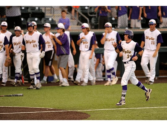 Wylie's Zach Smith (39) celebrates as he trots to the
