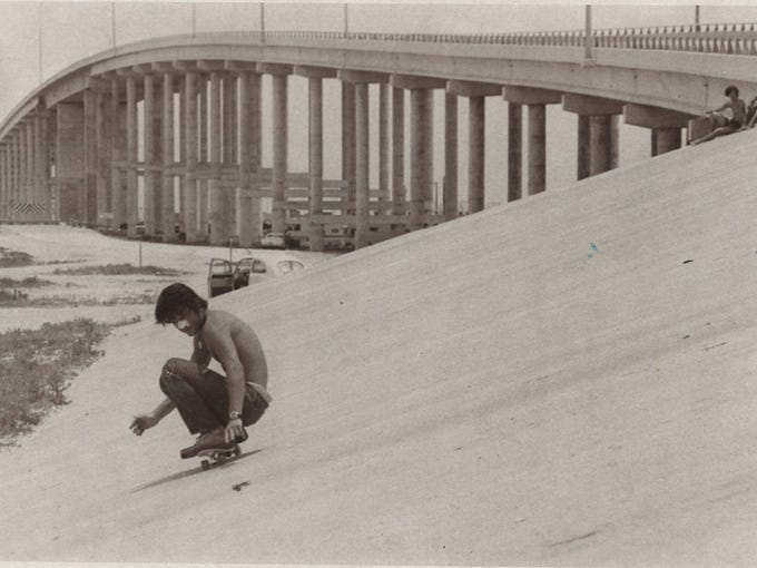 An unidentified skateboarder rides down the slope of