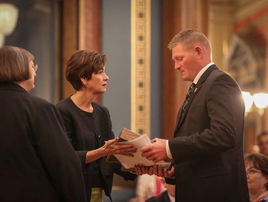 Iowa Gov. Kim Reynolds greets Spc. Agent Danny Miller