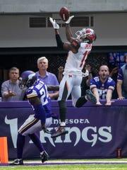 Tampa Bay Buccaneers wide receiver DeSean Jackson catches a touchdown pass over Minnesota Vikings cornerback Tramaine Brock Sr. during the third quarter at U.S. Bank Stadium.