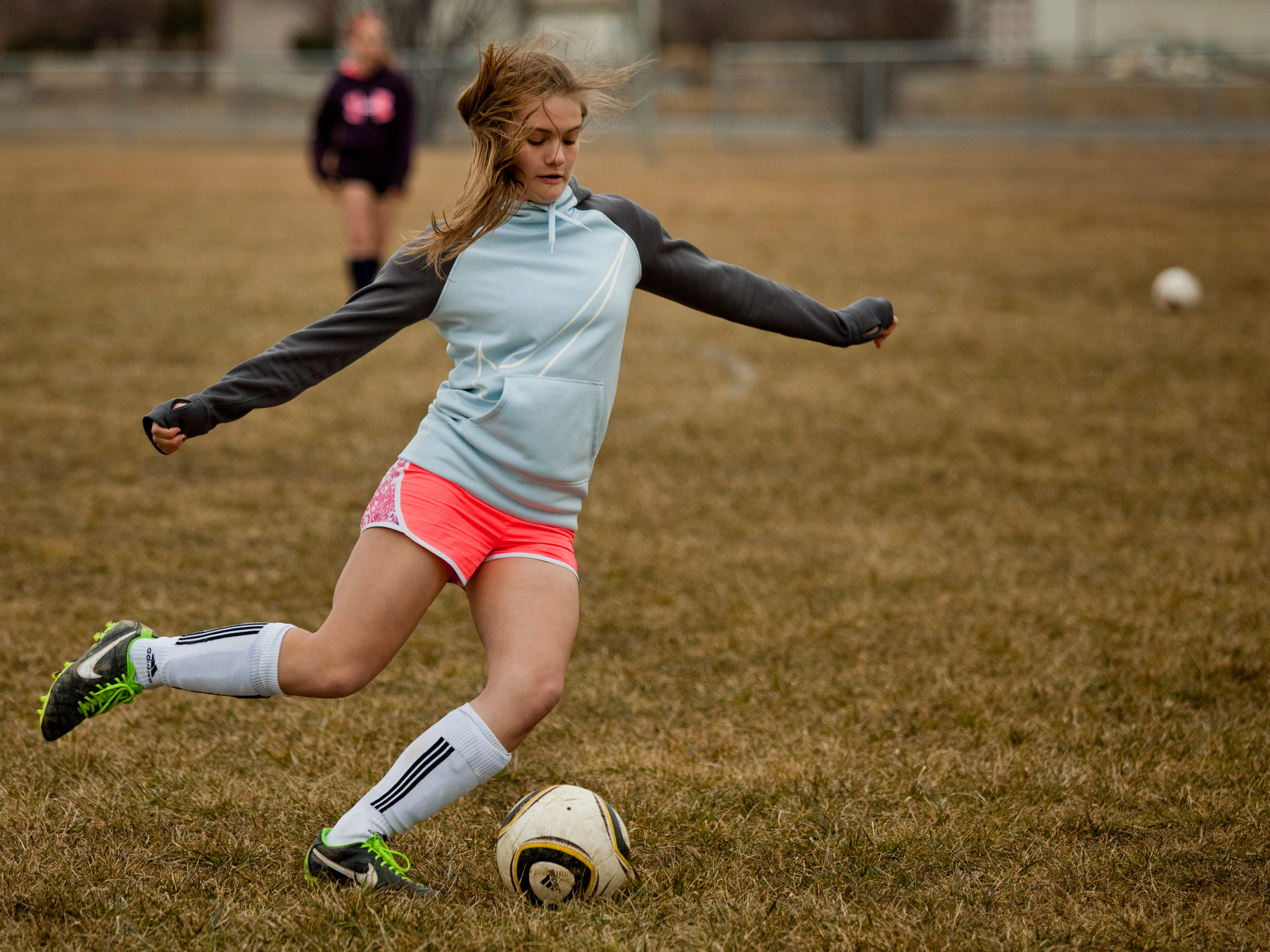 Freshman Riley Druia passes the ball during practice Thursday at Brockway Township Park.