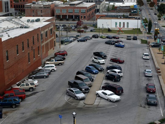 The parking lot at the northwest corner of Olive Street