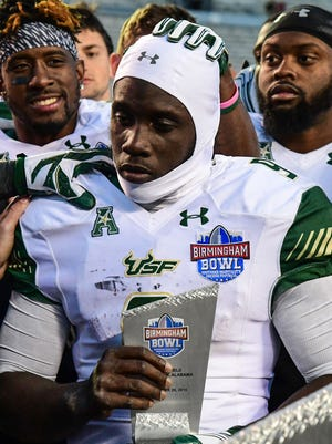 South Florida Bulls quarterback Quinton Flowers (9) accepts the MVP award after the 2016 Birmingham Bowl against the South Carolina Gamecocks at Legion Field. South Florida won 46-39 in overtime.