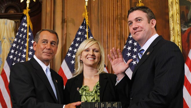 Then-House Speaker John Boehner of Ohio, left, administers the House oath to Rep. Duncan D. Hunter, R-Calif., during a mock swearing-in ceremony on Capitol Hill in Washington, Jan. 5, 2011.