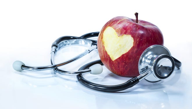 apple with stethoscope