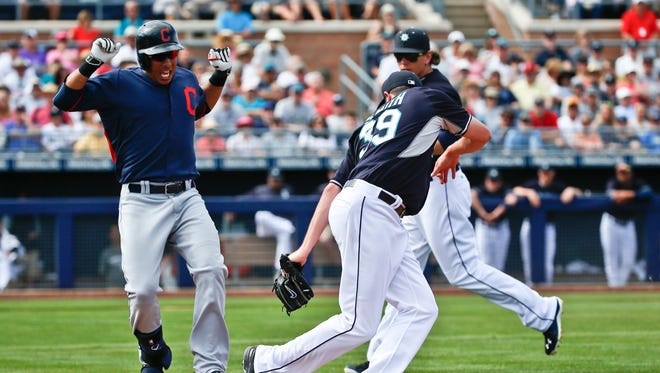 Cleveland Indians' Michael Brantley is out at first as Seattle Mariners relief pitcher Carson Smith steps on the base in the sixth inning of a spring training baseball game Monday, March 9, 2015, in Peoria, Ariz.