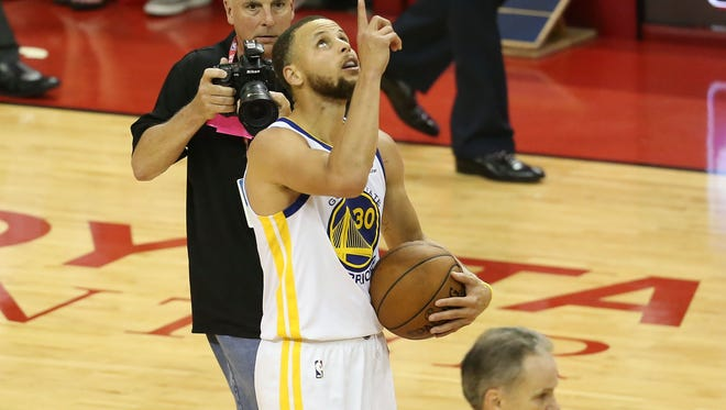 Golden State Warriors guard Stephen Curry (30) reacts after defeating the Houston Rockets in game seven of the Western conference finals of the 2018 NBA Playoffs at Toyota Center.