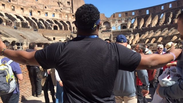 Michigan defensive lineman Maurice Hurst makes a grand entrance to the Colosseum.