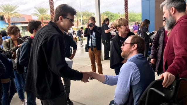 """Shadow Hills High School student Mick Wyman shakes hands with Will Latzenheiser, star of """"Stumped,"""" which was screened for students courtesy of the Palm Springs International Film Festival."""
