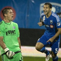 Montreal Impact's Dilly Duka celebrates his second-half goal as New England Revolution goalie Jermaine Jones reacts during an MLS soccer match Saturday, Sept. 19, 2015, in Montreal. (Peter McCabe/The Canadian Press via AP)