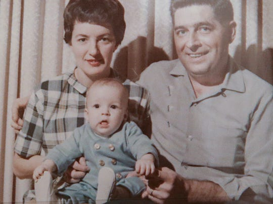 Mary Kay and Paul Becher with their adopted son, Chris Becher, when he was about three months old.