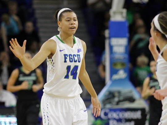 FGCU guard Whitney Knight (left) high-fives Steph Haas during Saturday's game against Stetson.