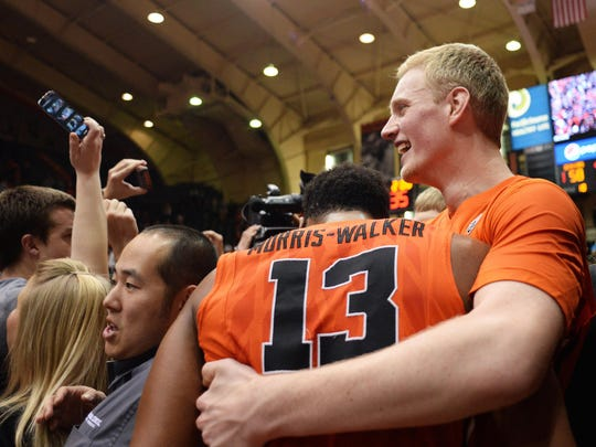Oregon State guard Langston Morris-Walker (13) and forward Olaf Schaftenaar (right) celebrate after defeating No. 7 Arizona, 58-56 at Gill Coliseum on Jan. 11, 2015.