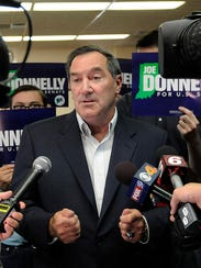 Sen. Joe Donnelly takes questions from the media on