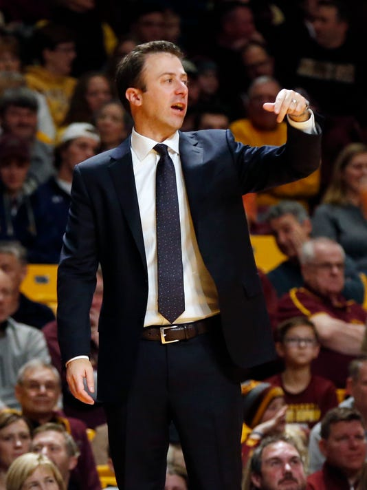 Minnesota head coach Richard Pitino directs his players in the second half of an NCAA college basketball game against Florida Atlantic, Saturday, Dec. 23, 2017, in Minneapolis. (AP Photo/Jim Mone)