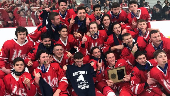 North Rockland players celebrate their 3-2 victory over Suffern in the Section 1 hockey championship game at Brewster Ice Arena Feb. 24, 2018.