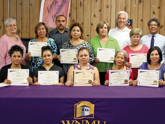 Ten Compass Manfuacturing employees recently completed the WNMU-Deming Language Institute's ESL (English as a Second Language) course. Seated from left are: Mariana Ray, Ana Baeza, Araceli Leaños, Emma Sepulveda and Veronica Barraza. Standing from left are: instructor Nancy McKeand, Cecilia Soto, Plant Manager Martin Valdez, Rosa Guzman, Maria Elda Ruiz, Language Institute Director Manuel Rodriguez, Angelina Benavidez, and WNMU Vice President for External Affairs Magdaleno Manzanarez. Missing from the photo was student Luz Nuñez.