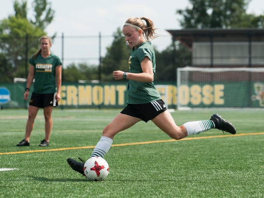 Freshman Ella Bankert winds up for a kick as the UVM