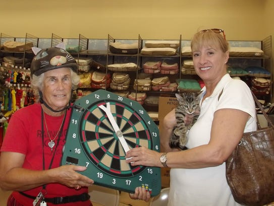 Paula Szekeres of Vero Beach spins the wheel to reduce