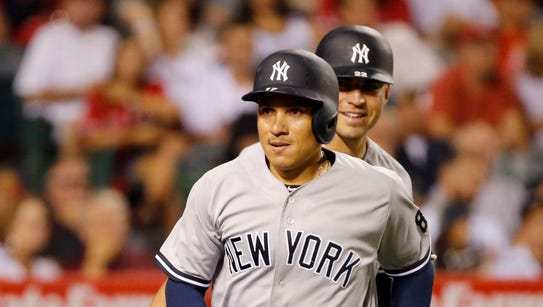 The New York Yankees' Ronald Torreyes heads for the