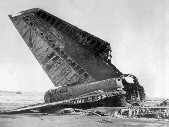 A burnt tail section of KLM jumbo jet lies on runway
