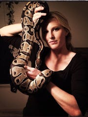 Greenville's Sandi Morris poses with one of her five pet snakes.