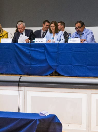 The U.S. House Homeland Security Subcommittee holds a rare field hearing at the University of Arizona College of Medicine-Phoenix, Wednesday, May 30, 2018, to discuss the national opiod crisis.  Gov. Doug Ducey, left, addresses the panel.
