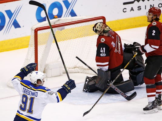 St. Louis Blues right wing Vladimir Tarasenko (91) celebrates a goal by teammate defenseman Alex Pietrangelo against Arizona Coyotes goalie Mike Smith (41) as Coyotes defenseman Luke Schenn (2) pauses near the goalie during the first period of an NHL hockey game Saturday, March 18, 2017, in Glendale, Ariz. (AP Photo/Ross D. Franklin)