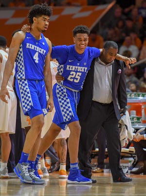 Jan 6, 2018; Knoxville, TN, USA; Kentucky Wildcats forward PJ Washington (25) is assisted off the court after an injury in the second half against the Tennessee Volunteers at Thompson-Boling Arena. Tennessee won 76 to 65.