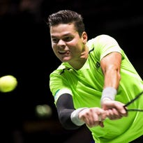 Canada's Milos Raonic returns the ball to Russia's Andrey Kuznetsov during their first round match of the ABN AMRO World Tennis Tournament in Rotterdam, Netherlands, on Feb. 10.