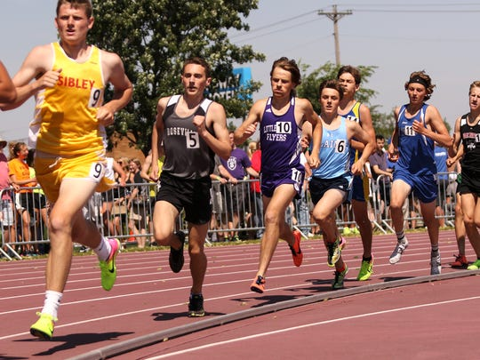 Little FallsÕ Tyler Mooreand SartellÕs Alex Nemeth compete in the boy's 1,600 meter run Saturday, June 10, during state track and field competition at Hamline University in St. Paul.