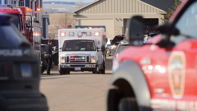 An ambulance leave the scene of a shooting outside of an apartment on the 9400 block of W. Karmya Circle in southwestern Sioux Falls Friday, Feb 26, 2016. Police say a man shot a woman then turned the gun on himself.