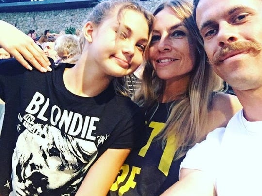 Stacey Hevener-Moss, middle, her daughter Corallyn, 12, and boyfriend, Shawn Clark, in a photo taken at a concert.