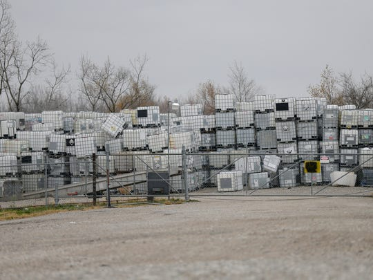 Large chemical containers are stacked outside IndyDrum