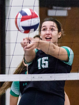 Greendale senior Annie Pulizos (15) bumps during the 2017 Indian Invite volleyball tournament at Menomonee Falls High school on Saturday, Sept. 30.