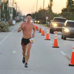 Runners on A1A near 9th St south and Atlantic Ave. at sunrise for 2nd Annual Ron Jon Half Marathon. The runner in the lead at about the three mile mark.